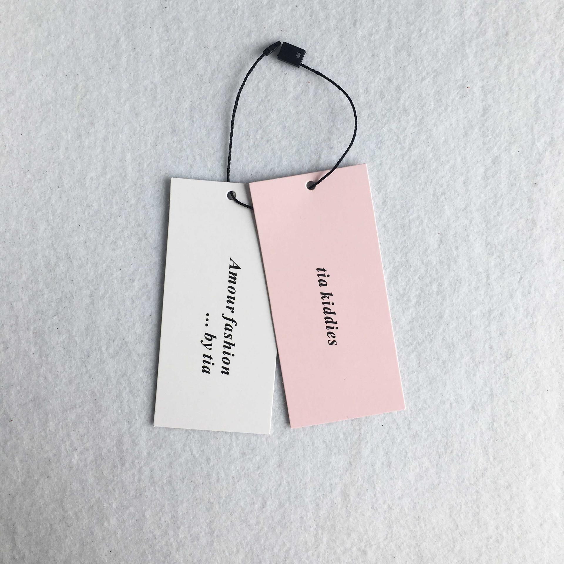 Low price custom brand coated paper pink printing swing tag hang tags