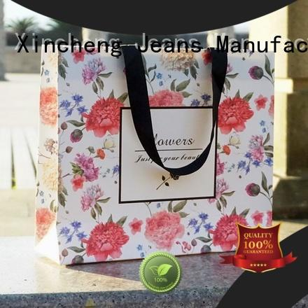 Xincheng Jeans available Paper shopping bag wholesale for store
